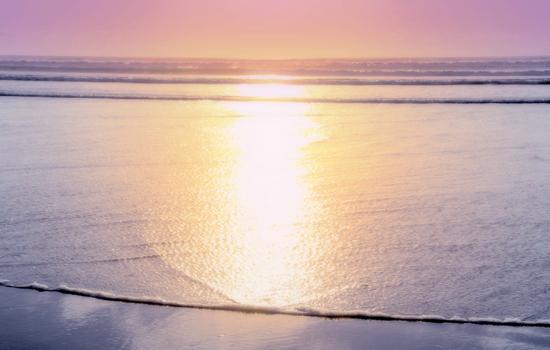 Strand bei Sonnenuntergang mit besonders sanften Farben
